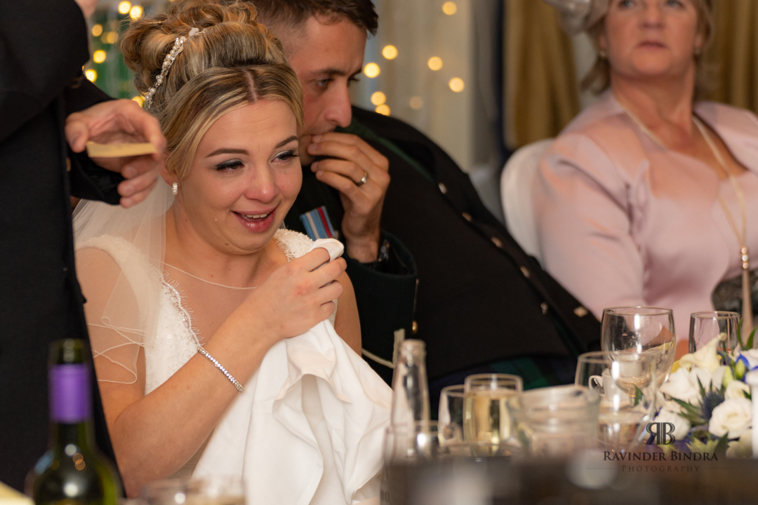 the bride sheds a tear during father speech at wedding reception