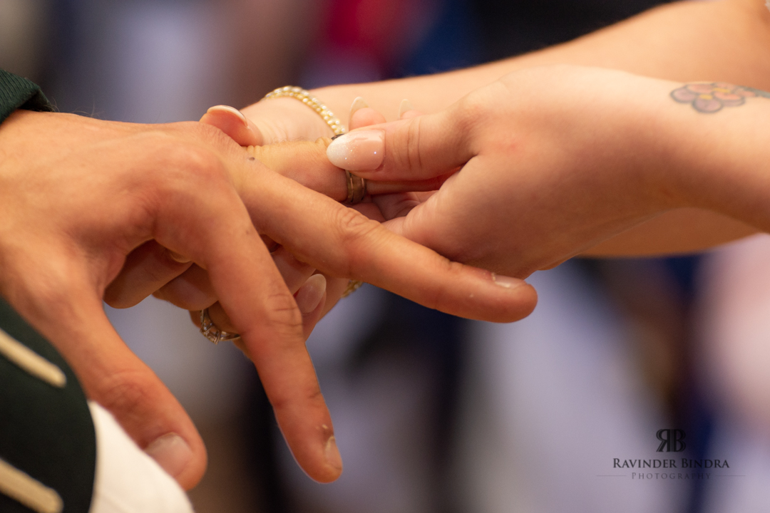 bride and groom exchanging weddings rings during the ceremony
