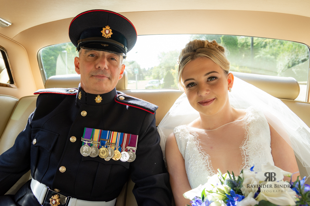 photo of father and bride in car on arrival to wedding ceremony
