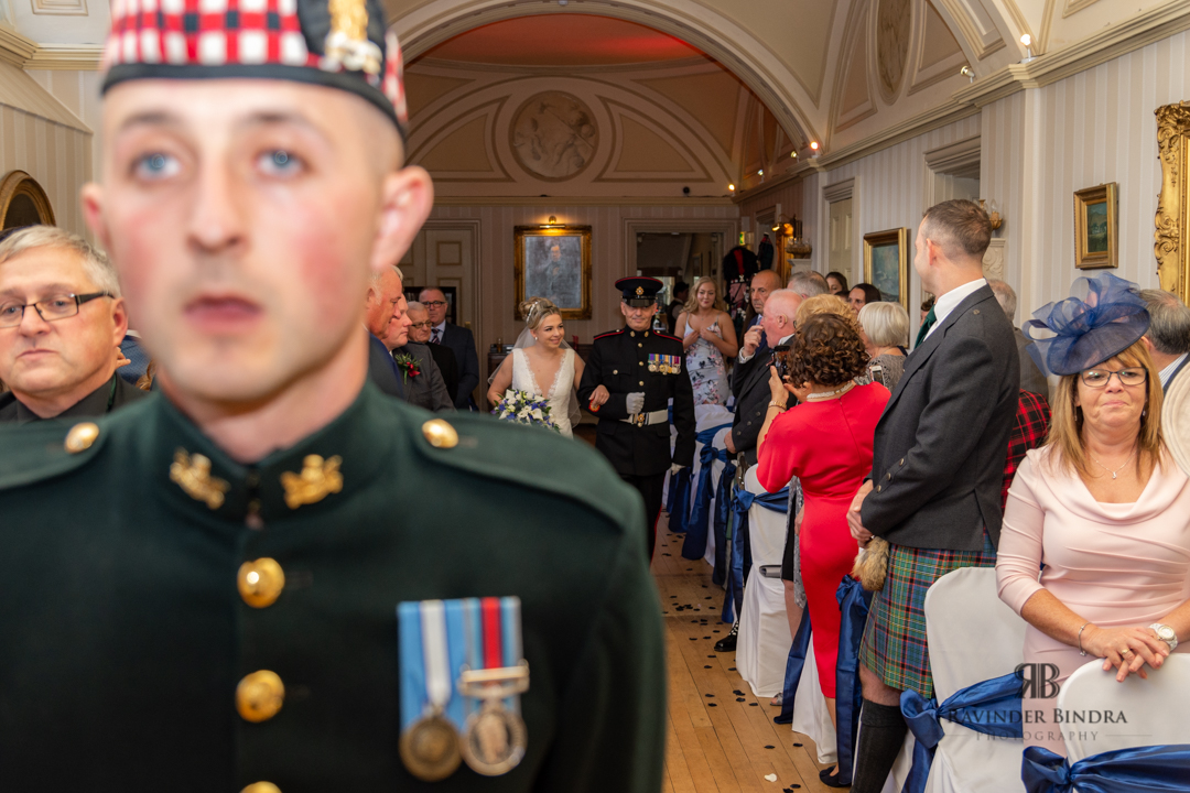 father and bride walk down the aisle as groom waits at fife wedding ceremony