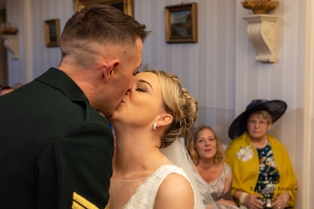 bride and groom sharing first kiss at their wedding ceremony at balbirnie house hotel
