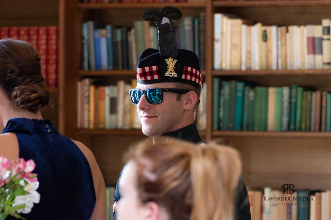 bestman wearing funny sunglasses at fife wedding