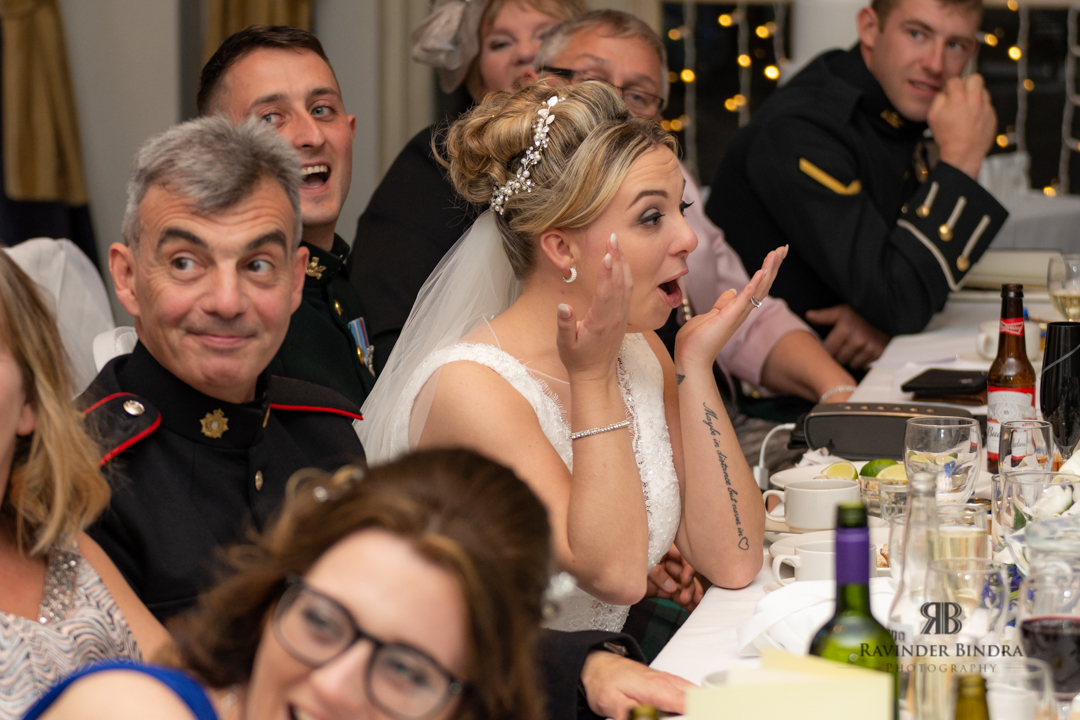 bride laughing during her wedding reception
