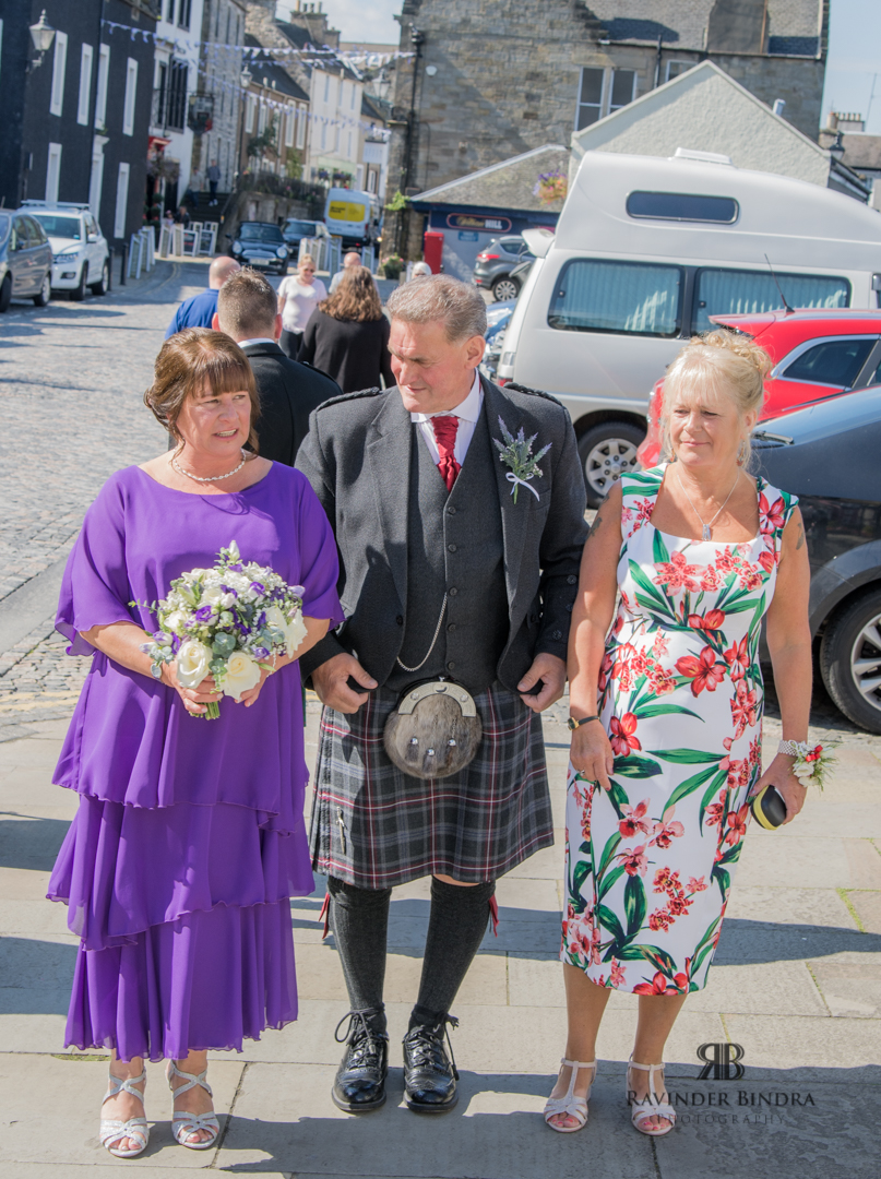 bride arrives to wedding ceremony in south queensferry