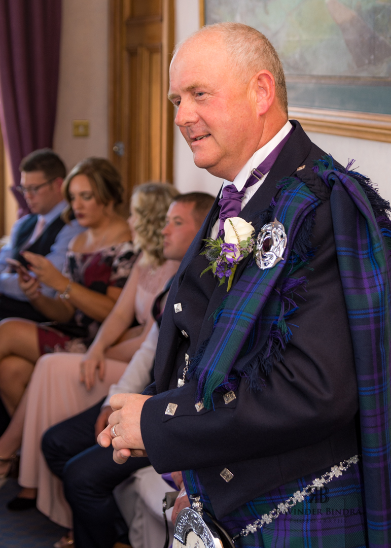 photo of groom at wedding ceremony