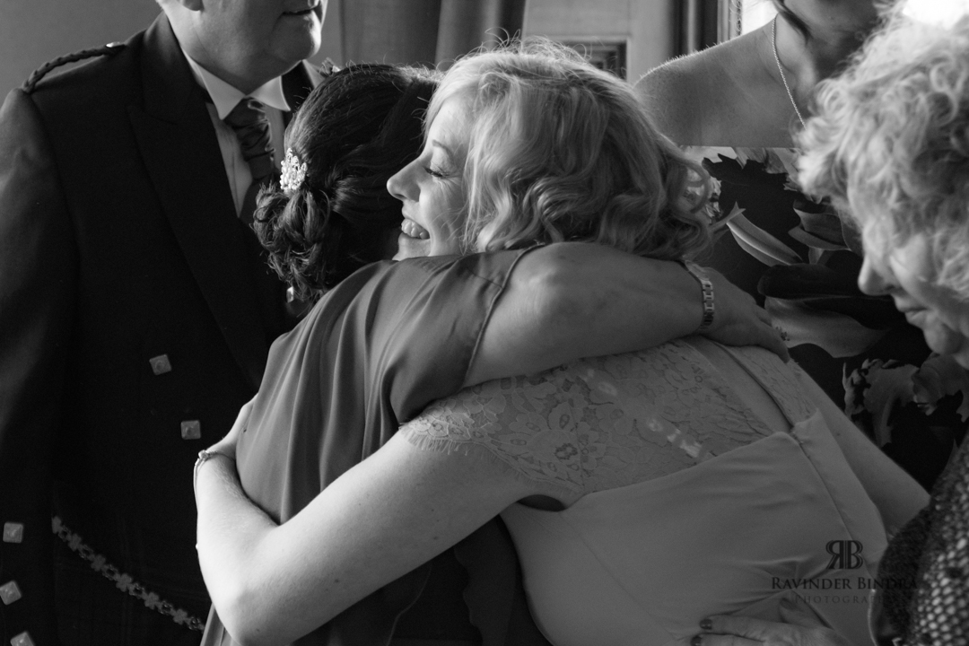 bride and friend hugging at fife wedding