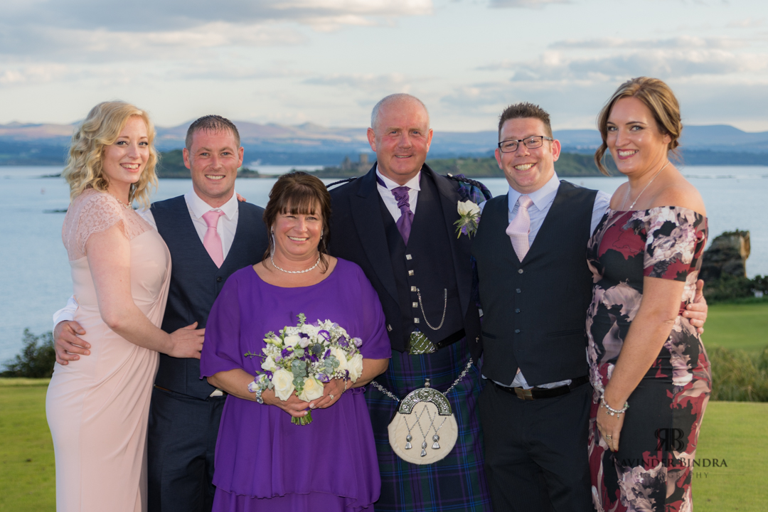 family wedding photo with bride and groom