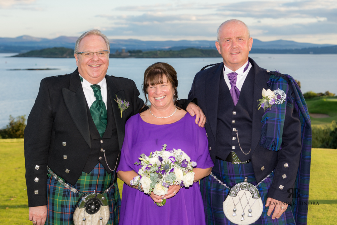 photo of bride and groom and family at fife wedding