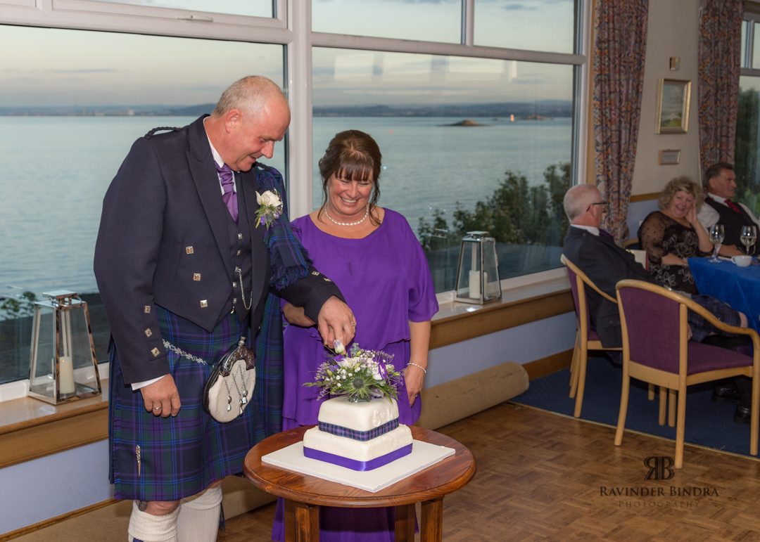 bride and groom cake cut